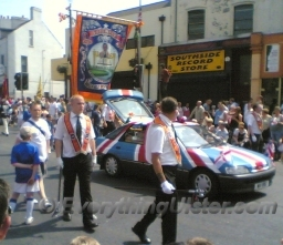 A Car painted in a Union Flag design travels with the parade